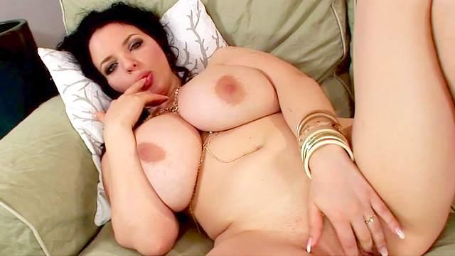 Fat brunette Joanna Bliss poses on sofa