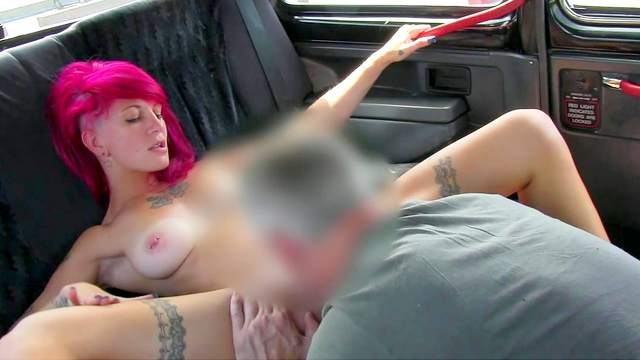 Tattooed redhead babe with piercing sucks driver's dick