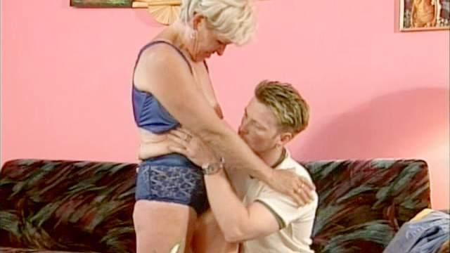 Blonde granny is sucking this tasty cock