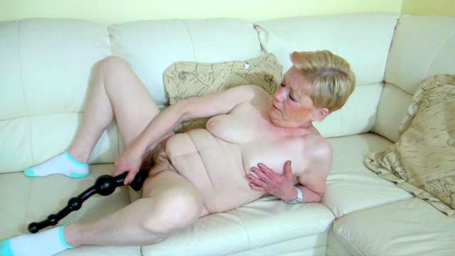 Granny is fucking her puss with a dildo