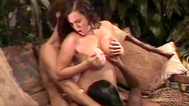 Brunette being fucked on the table in doggy style