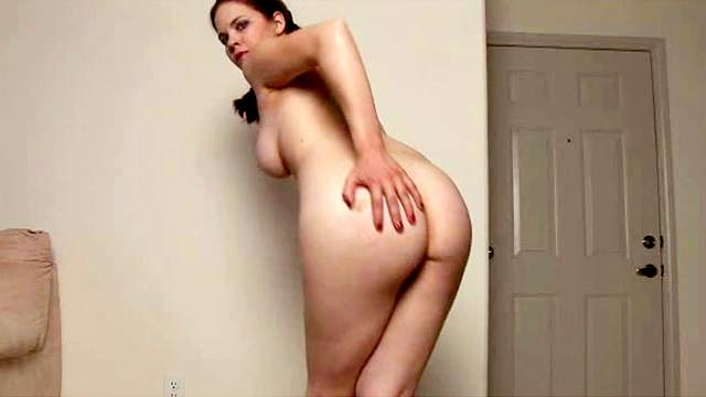 Brunette amateur with huge breasts exhibits her nude body
