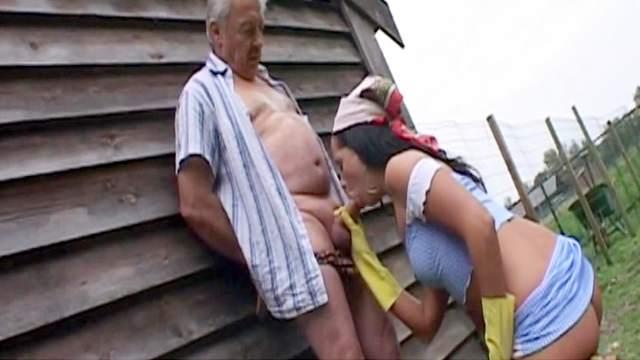 Slutty brunette wearing yellow gloves fucks with an old man