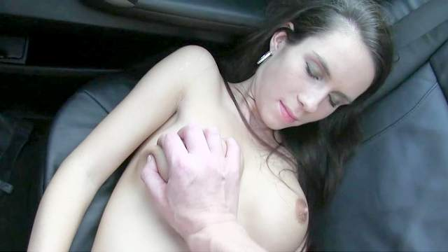 Brunette spreads her legs to get fucked in the car