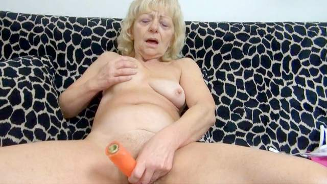 Old blonde Evan is playing with a hardcore dildo