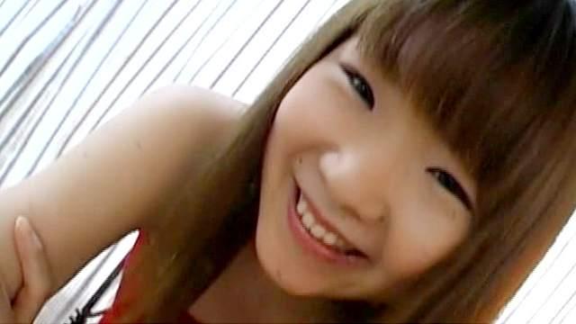 Slender Asian model is smiling in the cam