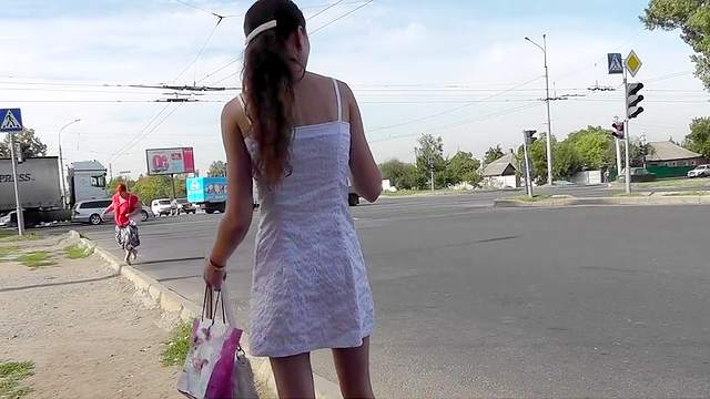 Young girl in sexy dress filmed outdoor upskirt