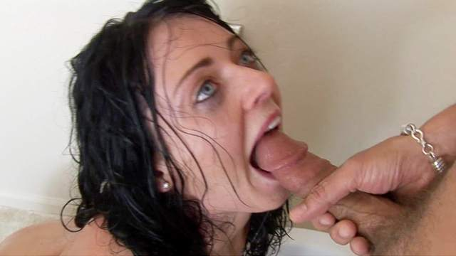 Brunette Sophie Dee is giving a deep blowjob