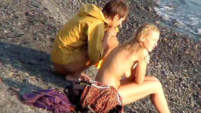 Beach, Blonde, Couple, Long hair, Natural tits, Nudist, Outdoor, Voyeur, Young girl
