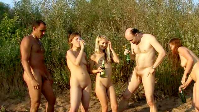 Nudists are posing totally naked