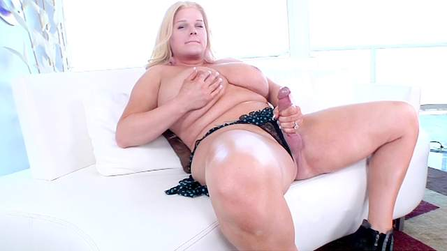 Solo shemale Holly Sweet is playing with cock