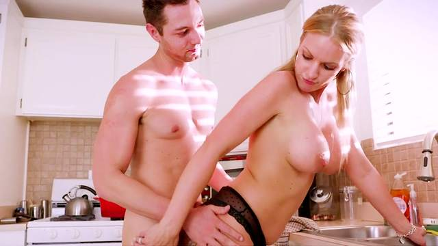 Step mom throats a big chunk of dick in the kitchen