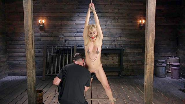 Pleasure and pain for submissive Cherie DeVille in a Dom's dungeon