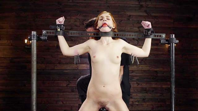 Submissive redhead ass fucked while being restrained