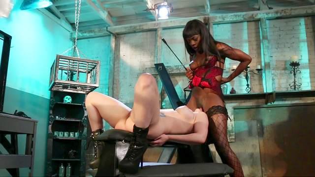 Ebony mistress plays with her slave girl pretty rough
