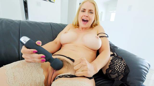 Fine busty MILF uses a big toy for her energized pussy
