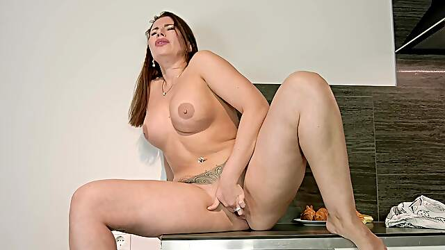 Insolent mature wife stands nude and horny as fuck