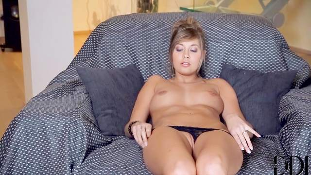 Solo girl Holly Pearce in black panties is drilling her shaved kitty in the house