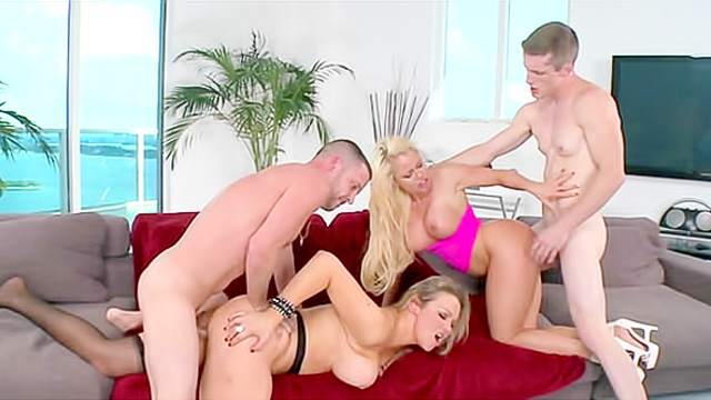 Foursome stars a couple of curvy cock whores